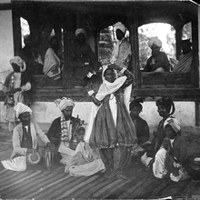 A group of musicians and a lady dancer